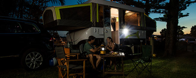 Family enjoying caravan and camping at night